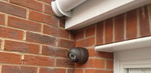 2.2MP cctv camera fitted to the brick wall of a house