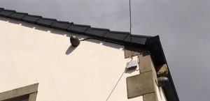 2.2MP dome camera fitted to side of house