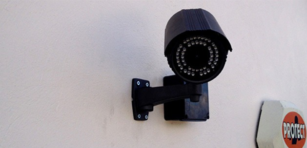 CCTV bullet camera fitted to a white wall