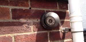 2.2MP Dome Vandal Proof Camera installed to a brick wall