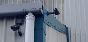 bullet camera installed to side of corrugated iron building