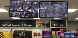 2 monitors with cctv images installed in a convenience store